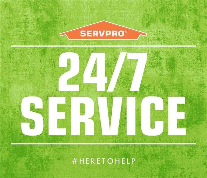 SERVPRO orange house and 24/7 service written on a green background