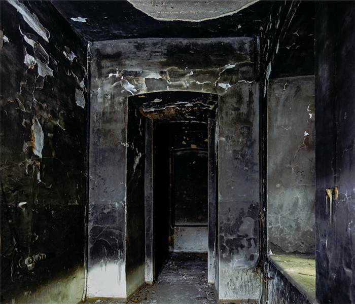 a room with soot covering all of the fire damaged walls