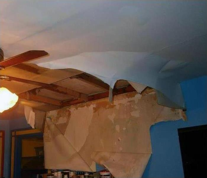 A roof caving in after a storm hit this home